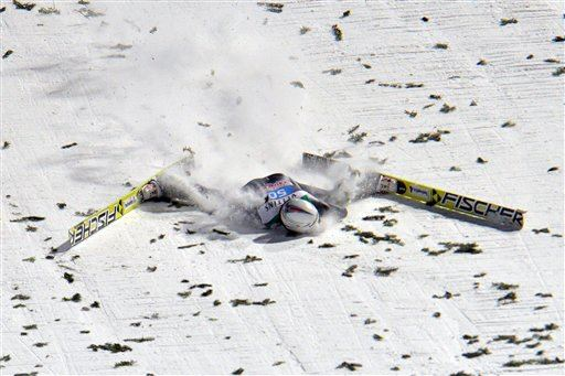 Switzerland's Simon Ammann crashes during the final jump of the fourth stage of the four hills ski jumping tournament in Bischofshofen, Austria, on Tuesday, Jan. 6, 2015. (AP Photo/Kerstin Joensson)